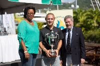 Fred Pilkington being presented with the IMA Line Honours Trophy by the Honourable Yolande Bain-Horsford, Minister for Tourism and Civil Aviation and Andrew McIrvine, RORC Admiral and IMA Secretary General - Photo RORC/Arthur Daniel & Olando K Romain